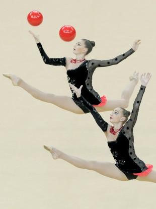 Two members of the Ukraine team perform during the Visa International Gymnastics.