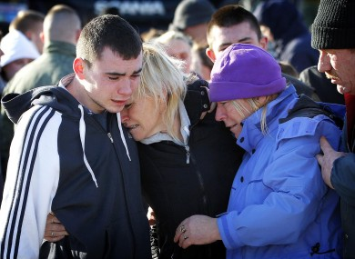 The family of Kevin Kershaw including mother Margaret (centre), brother Ciaran (left) and aunt Ann (right), walk behind the hearse containing his body after he became the second crew member to be recovered from the sea at Union Hall.