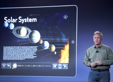 Apple's Philip Schiller displays some of the books available on the iBookstore at an event in New York today.