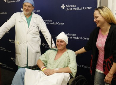 Neurosurgeon Leslie Schaffer, left, smiles with his patient Dante Autullo, and Dante's fiance, Gail Glaenzer during a news conference at Advocate Christ Medical Center in Illinois yesterday