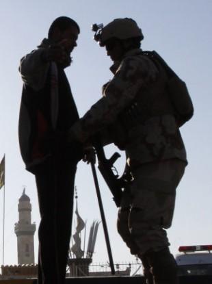 Iraqi police search a Shiite pilgrim in Basra on 22 January.