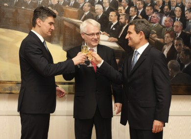 Croatia's president Ivo Josipovic, center, prime minister Zoran Milanovic, left, and the Parliament speaker Boris Sprem make a toast upon hearing unofficial results of the referendum last night