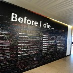 The Before I Die wall, where members of the public write what they want to do before they die, which forms part of the Boxed: Fabulous Coffins from the UK and Ghana collection at the Royal festival Hall in London.