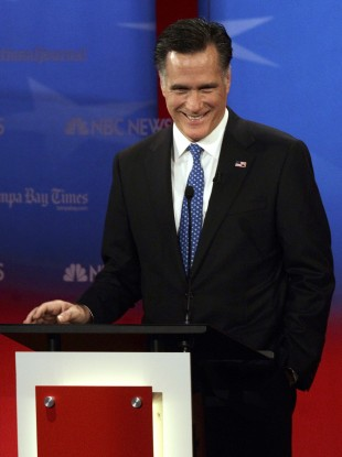 Romney smiles during a debate in Tampa, Florida last night.
