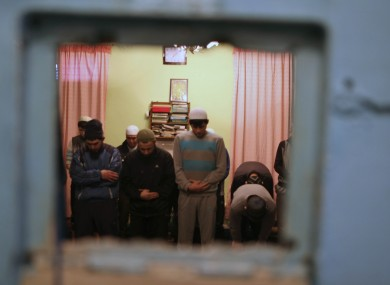 Inmates gather to pray at a detention centre in Bishkek, Kyrgyzstan