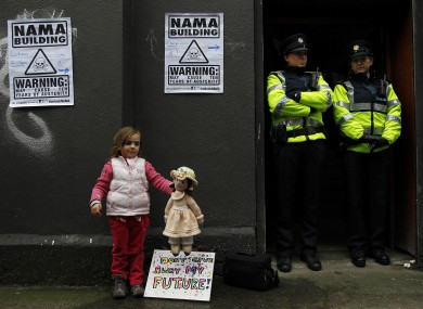 Orla Jennings, aged four, with gardaí outside the building this afternoon