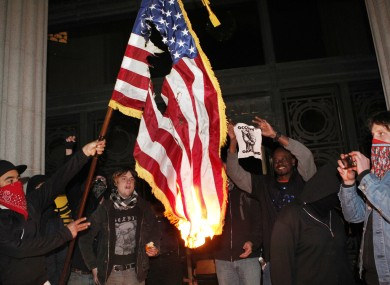 Occupy Oakland protestors burn an American flag found inside Oakland City Hall during an Occupy Oakland protest on the steps of City Hall on Saturday