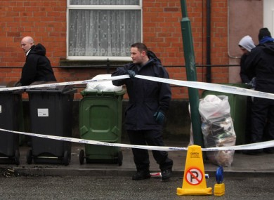 Garda and forensic officers at the scene off Blackhorse Avenue in Dublin, where the body of a woman was found murdered and dumped on the street in a suitcase.