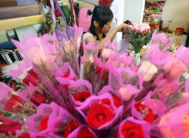 A florist prepares roses in a Kuala Lumpur shop
