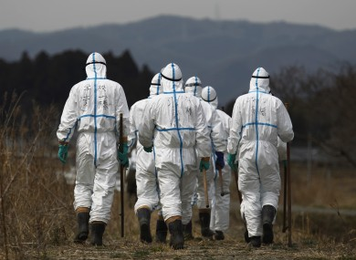 Police officers in Fukushima last April wearing suits to protect them from radiation