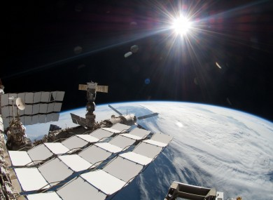 2011 photo from NASA showing the sun, a portion of the International Space Station and Earth's horizon