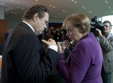 Hans-Peter Friedrich (left) has become the most senior member of Angela Merkel's cabinet to suggest that Greece should leave the eurozone.