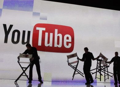 Stage crew workers prepare the set for a keynote speech by YouTube at the 2012 International Consumer Electronics Show, Thursday, Jan. 12, 2012, in Las Vegas.