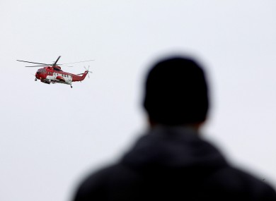 Mohammed Ali Eldin, father of missing trawlermen Saied Ali Eldin, watches a rescue helicopter take part in the search for the Tit Bomhomme last month