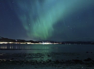 The aurora borealis, or Northern Lights, are seen near the city of Trondheim, Norway Tuesday January 23, 2012