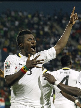 Asamoah Gyan celebtrating his goal against Mali in the group stages.