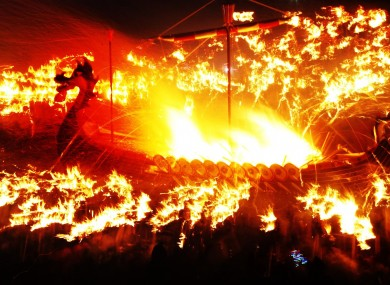 A Viking galley is set on fire during the Up Helly Aa Viking festival, in Lerwick on the Shetland Isles