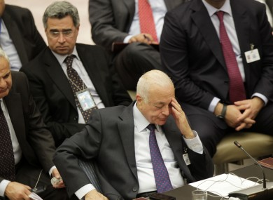 Secretary General of the League of Arab States Nabil Elaraby gestures while listening to Syrian Ambassador to the United Nations Bashar Ja'afari speak during a Security Council meeting in New York last night