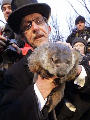 Groundhog Club handler Ron Ploucha holds Punxsutawney Phil, the weather prognosticating groundhog, during the 126th celebration of Groundhog Day on Gobbler's Knob in Punxsutawney, Pennsylvania earlier today