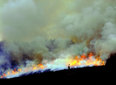 Gamekeepers carry out the centuries-old tradition of heather burning on the North Yorkshire Moors
