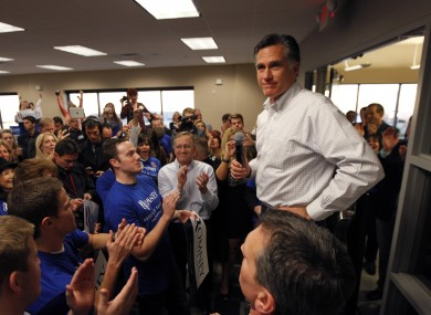 Mitt Romney greets campaign volunteers at a phone bank in Las Vegas yesterday. He is expected to easily win today's Nevada caucuses.