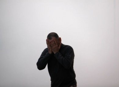 A man emerges from a tear gas cloud during recent clashes between police and protesters in Jidhafs, Bahrain.