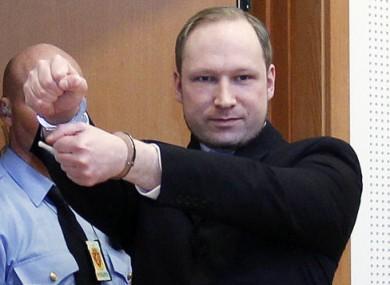 Anders Behring Breivik gestures in court.