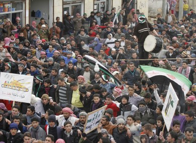 Anti-Syrian regime protesters hold a demonstration in Idlib, Syria on Monday