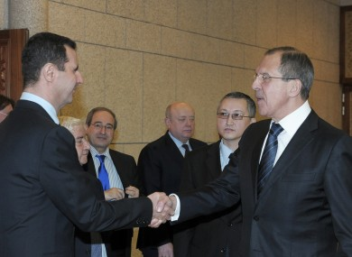 Bashar Assad, left, shakes hands with Russian Foreign Minister Sergei Lavrov, after talks in Damascus yesterday.