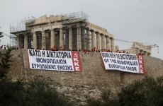 "Greek government warns rebel MPs of ""dangerous path"" to default"