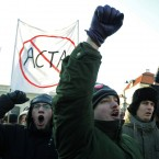 Protesters shout slogans as the demonstrate againt ACTA in front of the Presidential Palace in Warsaw, Poland. (AP Photo/Alik Keplicz/PA Images)