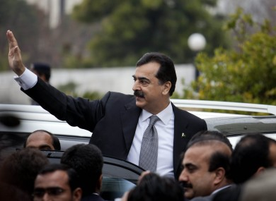 Pakistani Prime Minister Yousuf Raza Gilani waves upon his arrival at the Supreme Court for a hearing in Islamabad, Pakistan today