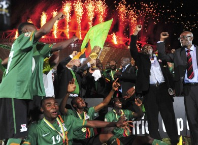 Former Zambian president, Kenneth Kuanda celebrates with the trophy.