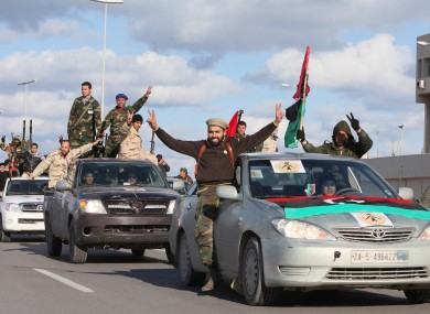 Libyan militias parade through Tripoli yesterday celebrating the one year anniversary of the uprising