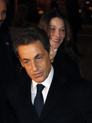 Sarkozy with wife Carla Bruni, arrives for an interview with French TV announcing his re-election bid.