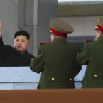 New North Korean leader Kim Jong Un waves after reviewing a parade of thousands of soldiers. (AP Photo/David Guttenfelder/PA Images)