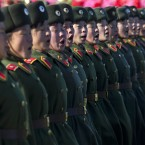 New North Korean women soldiers chant at Kumsusan Memorial Palace in Pyongyang during today's parade. (AP Photo/David Guttenfelder/PA Images)