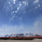 Fireworks explode over the heads of North Korean soldiers lined up in formation in Pyongyang today. (AP Photo/David Guttenfelder/PA Images)