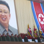 New North Korean leader Kim Jong Un bows his head as he stands with senior political and military leaders. (AP Photo/David Guttenfelder/PA Images)