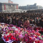 Flowers are laid at Kim Il Sung Square during today's commemorations of Kim Jong Il's death and what would have been his 70th birthday. (AP Photo/David Guttenfelder/PA Images)