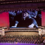 A large screen shows video recorded during the period of mourning following the death of late leader Kim Jong Il. (AP Photo/David Guttenfelder/PA Images)