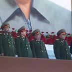 New North Korean leader Kim Jong Un looks down the line at military leaders at Kumsusan Memorial Palace in Pyongyang. (AP Photo/David Guttenfelder/PA Images)
