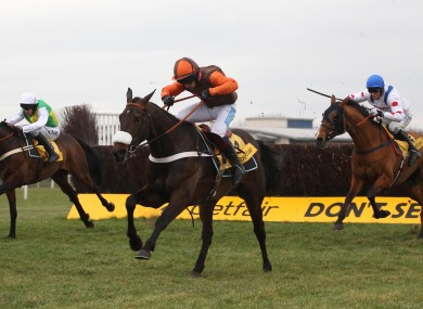 Long Run ridden by Sam Waley Cohen clears the last fence to win the The Betfair Denamn Steeple Chase.