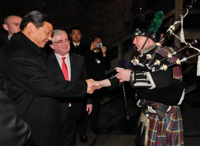 Chinese Vice-President Xi Jinping and Tanaiste Eamon GIlmore meet piper Neil Carey at Bunratty Castle.