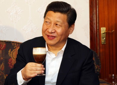Xi Jinping samples one of farmer James Lynch's Irish coffees during a visit to the Lynch Farm at Six Mile Bridge in Clare yesterday.