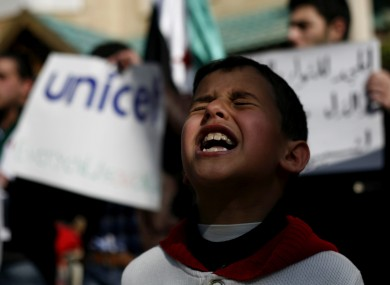 A Syrian boy chants slogans during a rally demanding UNICEF to protect Syrian children in front of the UNICEF Compound in Amman, Jordan