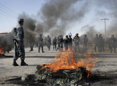 Protesters burn tyres at an anti-US demonstration in Kabul today
