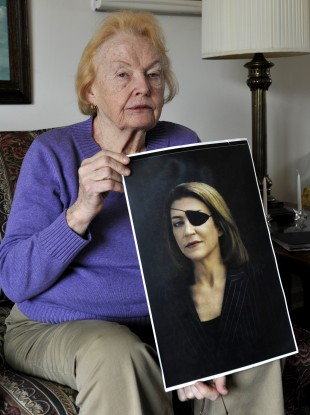 Marie Colvin's mother Rosemarie Colvin poses with her portrait today.