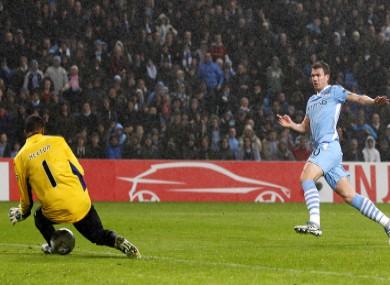Edin Dzeko (right) shoots to score Manchester City's second goal past FC Porto's goalkeeper Da Silva Helton.