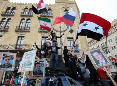Pro-Syrian regime supporters during a demonstration in Lebanon yesterday
